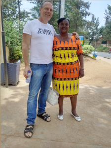 Dean stands with wafrican woman
