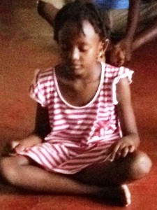African Girl Meditating during her first martial arts class